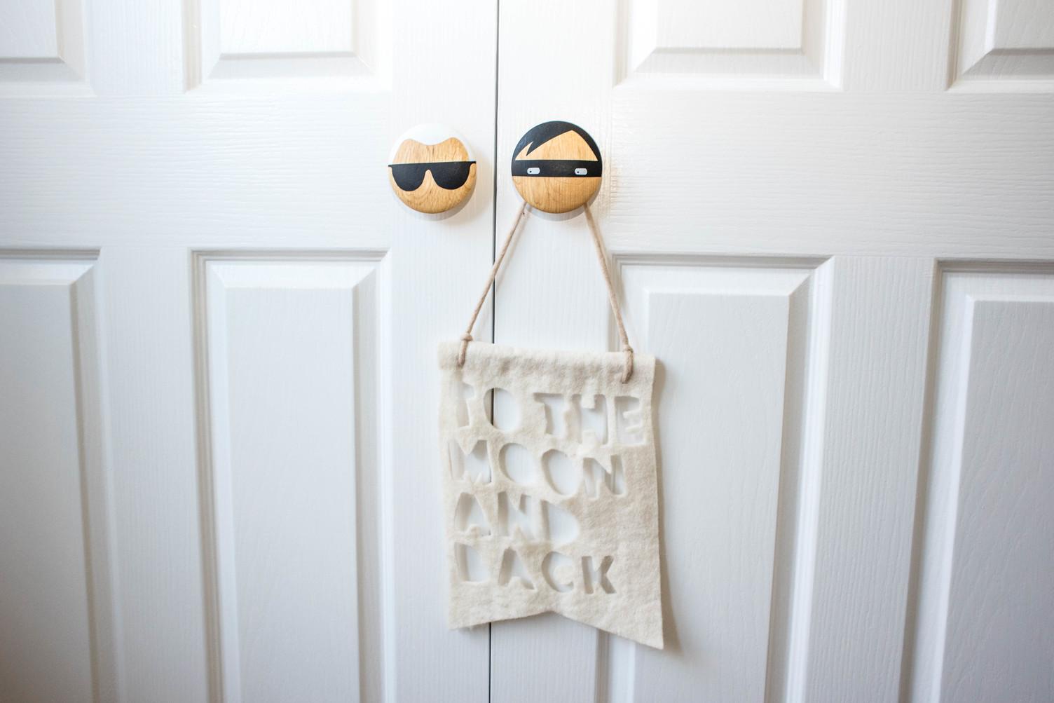 Wall hooks as door handles