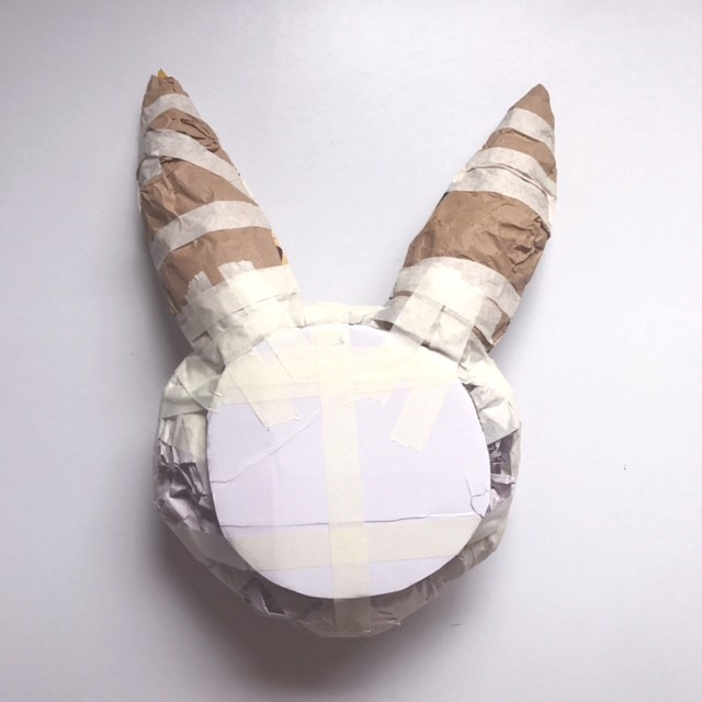 Attach ears, animal head paper mache